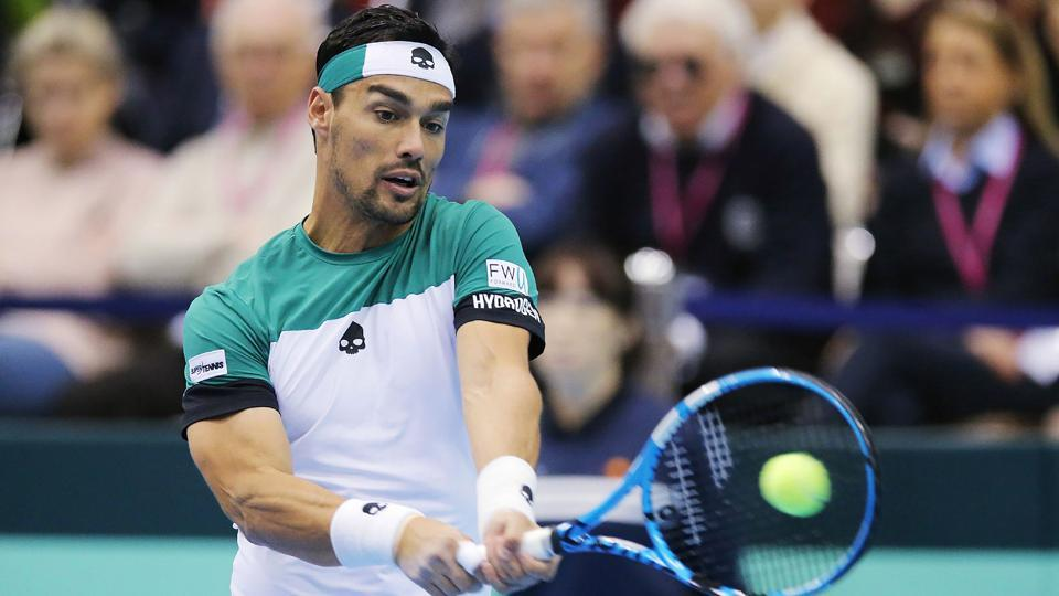 Italy's Fabio Fognini returns a shot against Japan's Yuichi Sugita in their Davis Cup World Group first round men's singles tennis match in Morioka, Iwate prefecture, on Sunday.