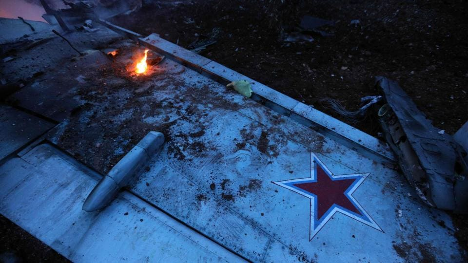 A picture taken on February 3 shows the wing of a downed Sukhoi-25 fighter jet in Syria's northwest province of Idlib.