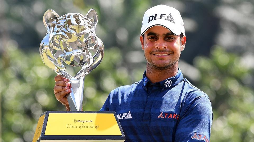 India's Shubhankar Sharma poses with the trophy after winning the 2018 Maybank Malaysia Golf Championship.