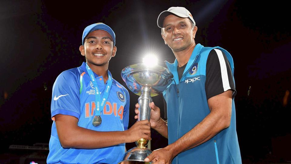 Indian team captain Prithvi Shaw and coach Rahul Dravid pose with the trophy after winning the ICC Under-19 Cricket World Cup finals in Mount Maunganui on Saturday. India beat Australia by eight wickets to win record fourth U-19 World Cup.