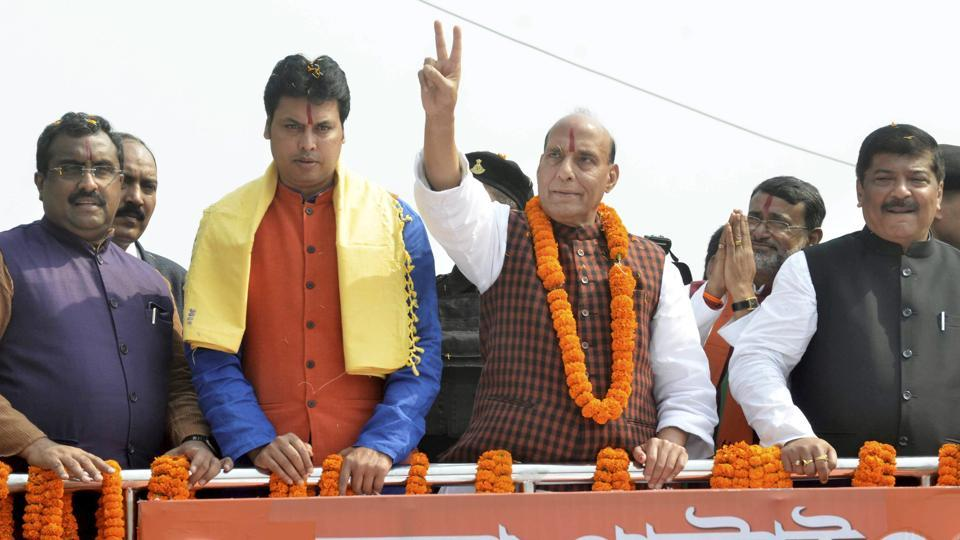 Union home minister Rajnath Singh addresses a gathering  an election rally in Agartala on Sunday.