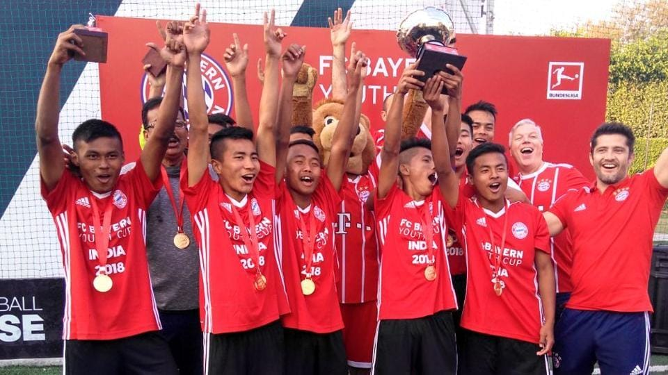 Army Public School Bangalore team celebrate at the podium of the FCBayern Yough Cup India in New Delhi on Sunday.
