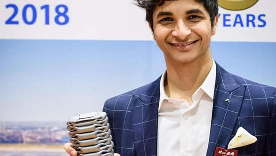 Grandmaster Vidit Gujrathi celebrate with the trophy after winning the Tata Open challenger event at Wijk Aan Zee, the Netherlands.