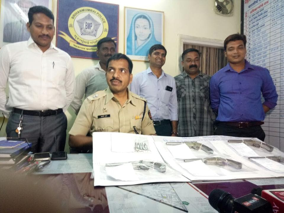 Police officers display the firearms they recovered from Kisan Kevat on Saturday