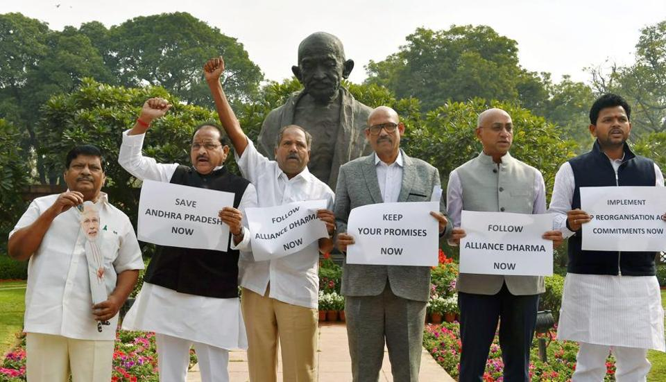 Telugu Desam Party (TDP) MPs display placards and raise slogans to 'save Andhra Pradesh' while staging a protest in front of Gandhi Statue in Parliament House in New Delhi on Monday.