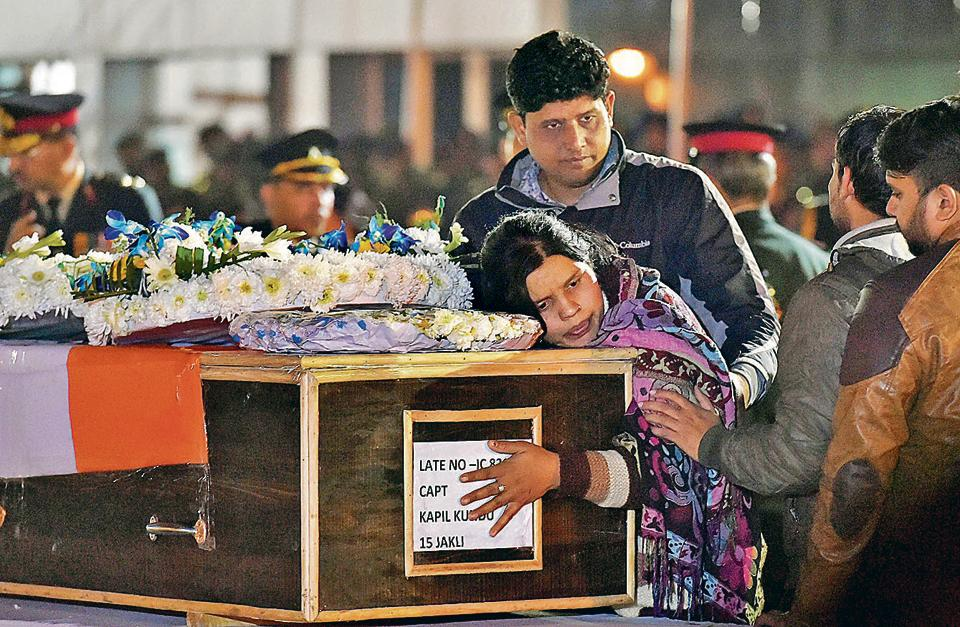 Captain Kapil Kundu's sister mourns while paying tribute to her brother after his mortal remains were brought at AFS Palam in New Delhi on Monday. Captain Kundu was among the four jawans killed in shelling by Pakistan in Kashmir's Rajouri district.