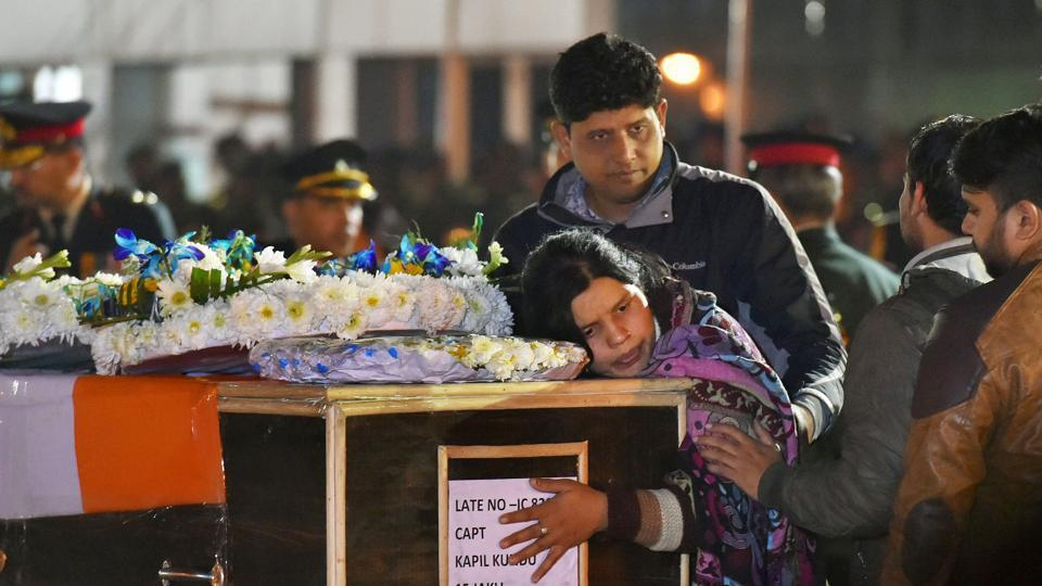 Captain Kapil Kundu's sister mourns while paying tribute to her brother after his mortal remains were brought at Air Force Station  Palam in New Delhi on Monday.