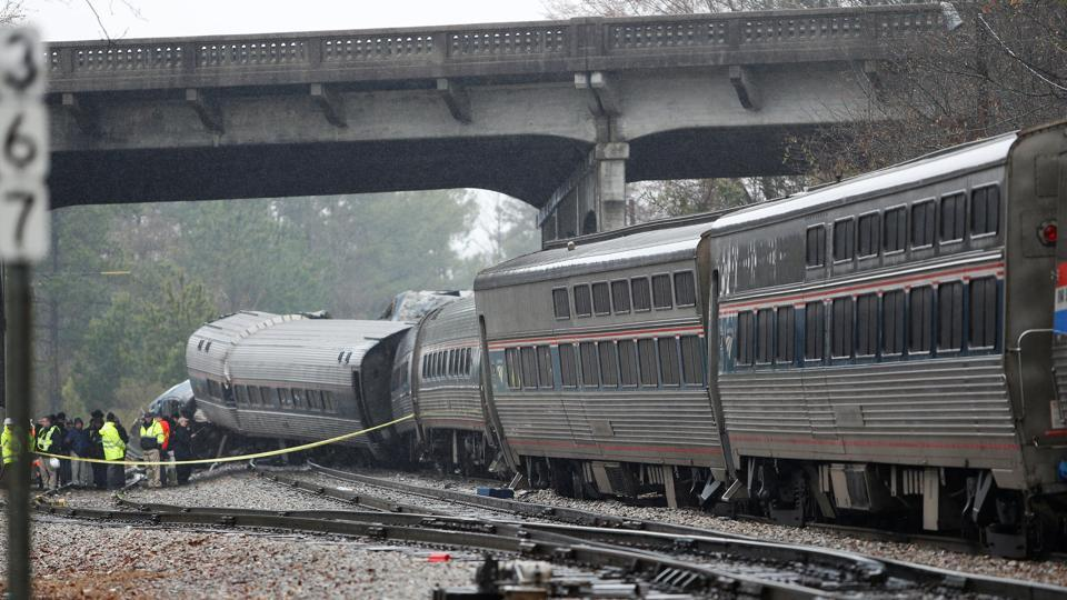 Emergency responders at the scene after an Amtrak passenger train collided with a freight train and derailed in Cayce, South Carolina, US, on February 4, 2018.
