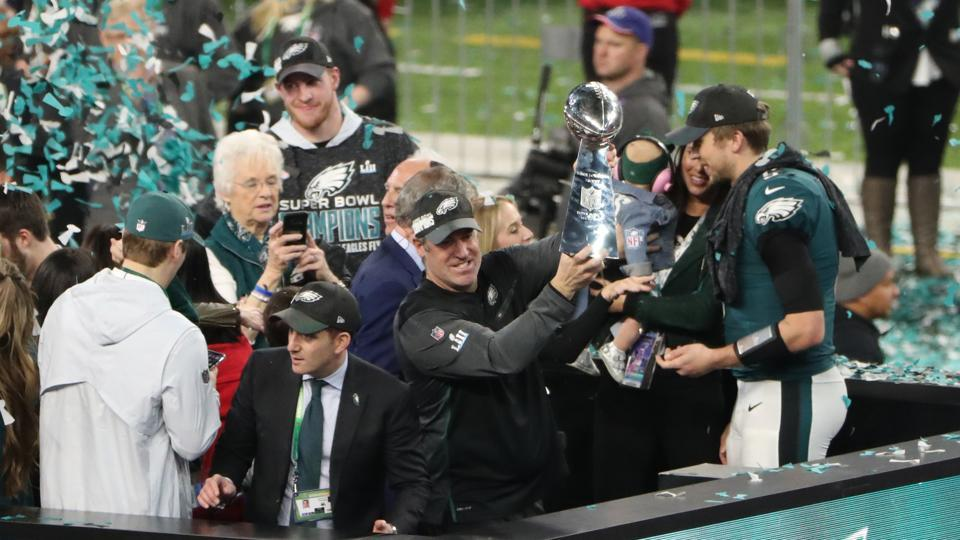 Philadelphia Eagles head coach Doug Pederson holds up the the Vince Lombardi Trophy after a victory over the New England Patriots in Super Bowl LII at U.S. Bank Stadium.