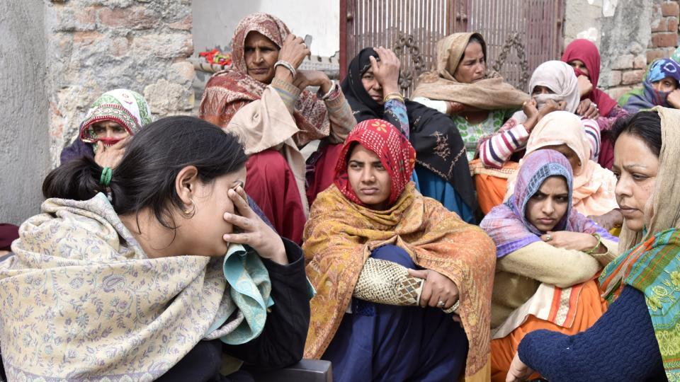 Relatives of Captain Kapil Kundu, one of the four soldiers killed in Pakistan shelling in Rajouri, mourn for him in his family's village near Pataudi in Haryana.
