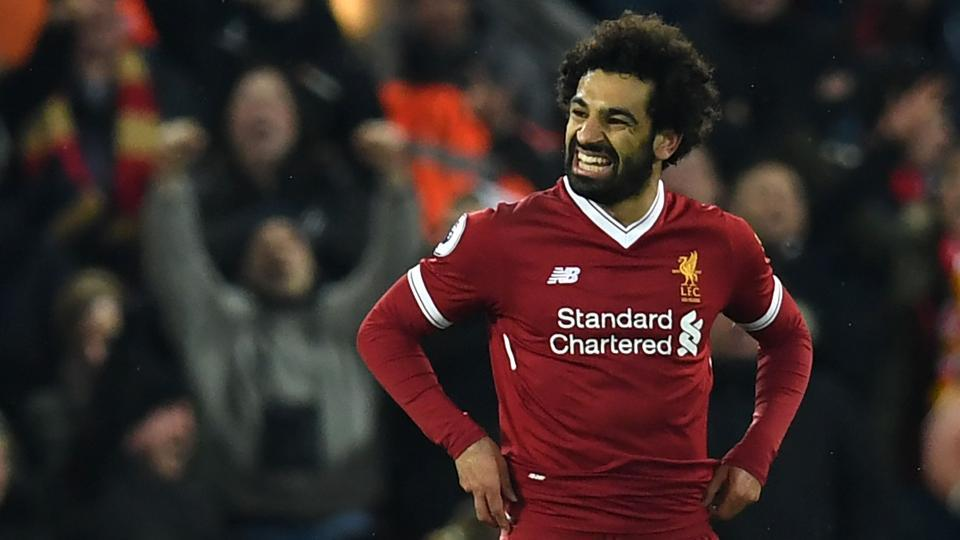 Liverpool's Egyptian midfielder Mohamed Salah celebrates scoring his team's second goal during the English Premier League football match against Tottenham Hotspur at Anfield in Liverpool on Sunday.