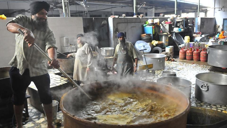 Langar being prepared at a gurudwara in Ludhiana. Every day an estimated 300 million people visit places of worship across the country and receive food which can be a small portion or a complete meal.