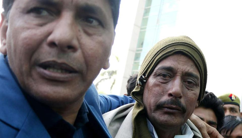 Jitendra Yadav's father in tears outside the Noida hospital on Monday.