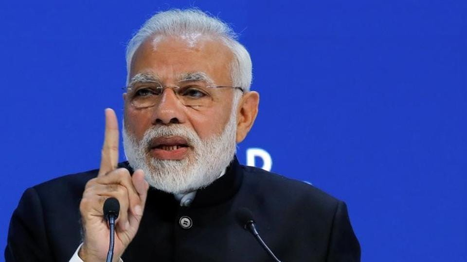 Narendra Modi gestures as he speaks during the Opening Plenary during the World Economic Forum annual meeting in Davos, Switzerland, January 23, 2018.