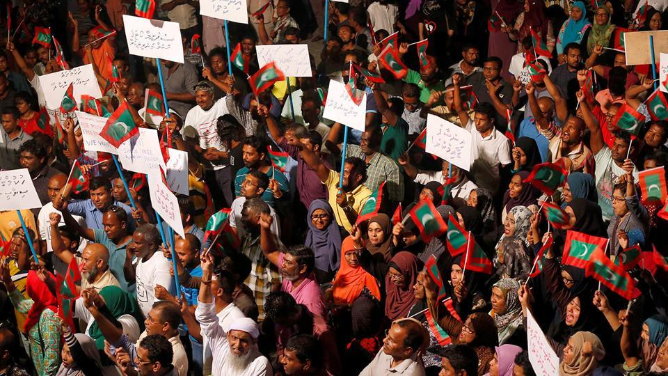 Opposition supporters protest the government's delay in releasing their jailed leaders, including former president Mohamed Nasheed, in Male on Sunday.