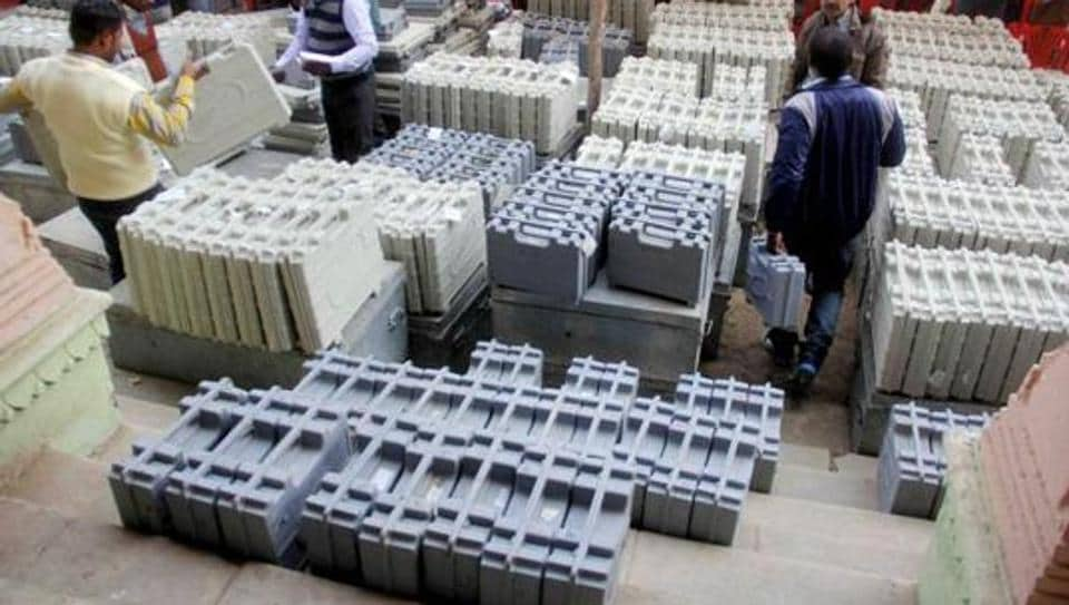 Polling officers collect electronic voting machines(EVM) and polling materials before leaving for polling booth on the eve of second phase voting of Uttar Pradesh Nagar Palika Election 2017 in Allahabad.