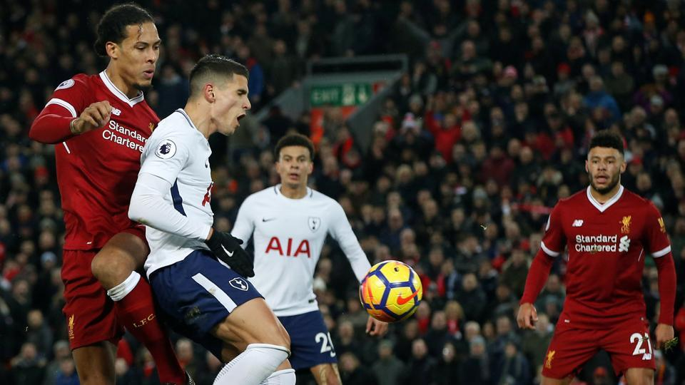 Liverpool's Virgil van Dijk fouls Tottenham's Erik Lamela for a penalty during their Premier League game at Anfield on Sunday. Van Dijk believes both Lamela and Harry Kane dived during the match to win penalties.