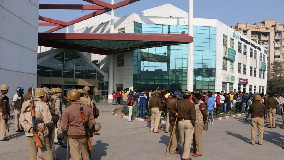Police force camps outside the Fortis hospital in Noida on Monday.