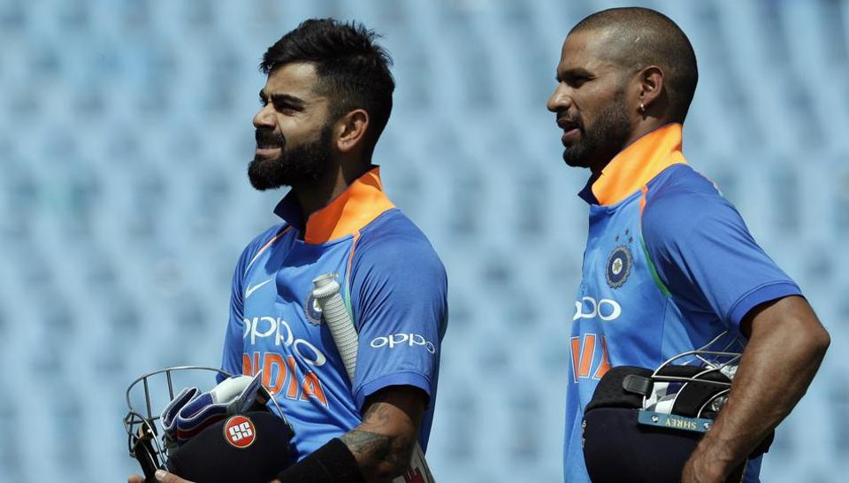 India's captain Virat Kohli (L) with teammate Shikhar Dhawan leave the field after winning their second ODI  against South Africa and India at Centurion Park in Pretoria on Sunday. India beat South Africa by 9 wickets.