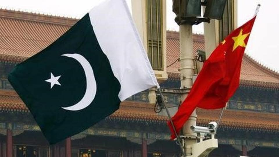 A Pakistan national flag flies alongside a Chinese national flag in Beijing.