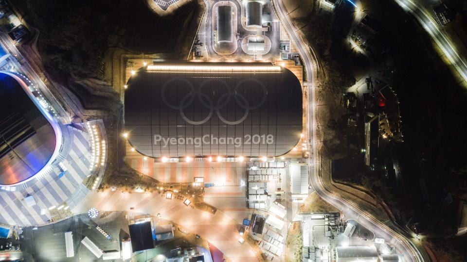 An aerialview shows the Olympic rings on the roof of the skating venue of the 2018 Pyeongchang winter Olympics in Gangneung. This will be South Korea's first Winter games and its second Olympic event after 1988's Summer Games. (Ed Jones / AFP)