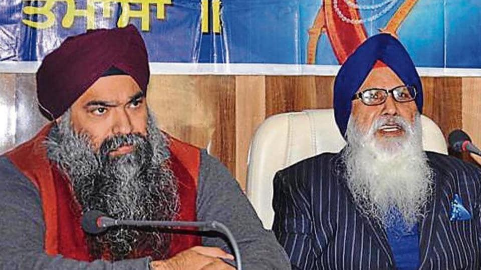 Former chief of Khalsa Diwan Charanjit Singh Chadha (R) with his son Inderpreet Singh, now deceased.