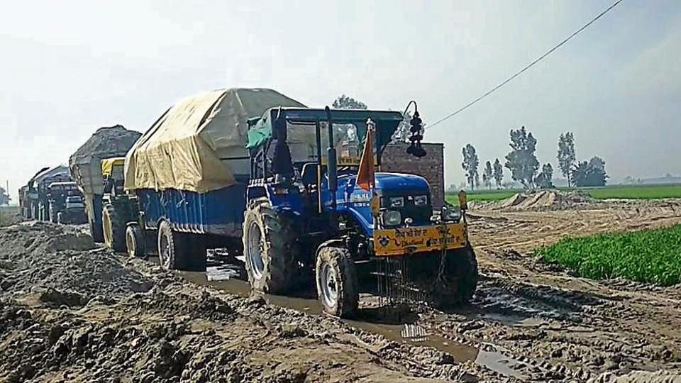 Tractor-trailers seized for illegal sand mining at Jalloke village in Tarn Taran on Monday;