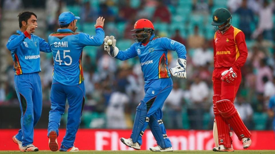 Rashid Khan (L) and Mohammad Nabi starred for Zimbabwe as they defeated Zimbabwe by 5 wickets in the first T20 international between the two sides at Sharjah on Monday.