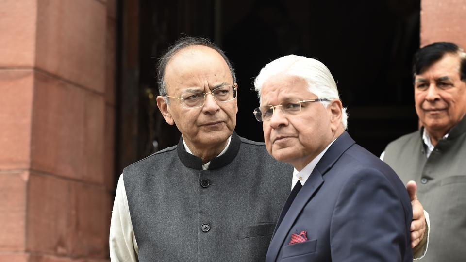 Finance minister Arun Jaitley with Congress leader Ashwani Kumar during the Budget session of Parliament, in New Delhi.