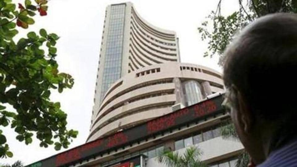 Sensex falls another 310 pts on domestic, global woes