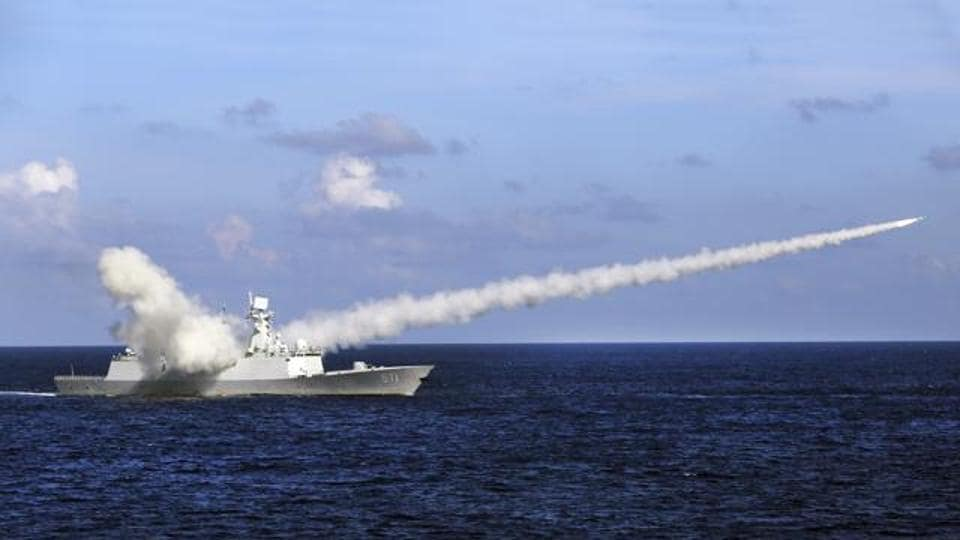In this Friday, July 8, 2016 photo released by Xinhua News Agency, Chinese missile frigate Yuncheng launches an anti-ship missile during a military exercise in the waters near south China's Hainan Island and Paracel Islands.