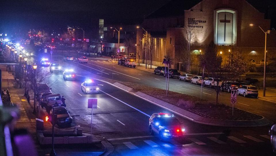 Public safety vehicles follow the hearse carrying the body of slain El Paso County Sheriff's Deputy Micah Flick, Monday, Feb. 5, 2018, in Colorado Springs.