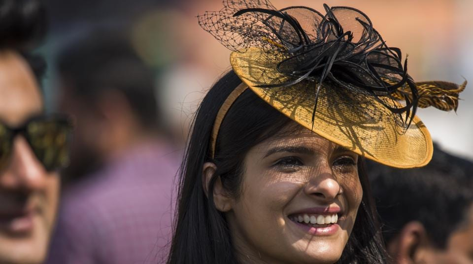 A young woman flaunts a dramatic hat at Mahalaxmi racecourse in Mumbai where the Indian Derby 2018 was held on Sunday, February 4. (Pratik Chorge / HT Photo)