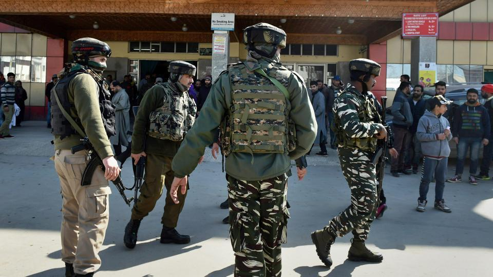 Security personnel stand guard during a search operation after an LeT militant escaped from the police custody with the assailants after Lashkar-e-Taiba militants attacked SMHS hospital, in Srinagar on Tuesday.
