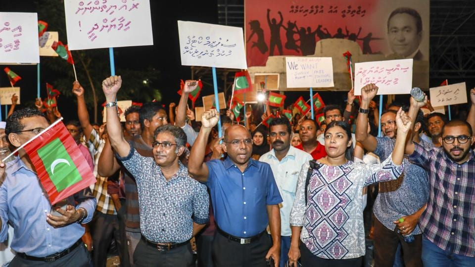 In this Feb.4, 2018 photo, Maldivian opposition supporters shout slogans during a protest as they the urge the government to obey a Supreme Court order to release and retry political prisoners, including an ex-president in Male, Maldives.