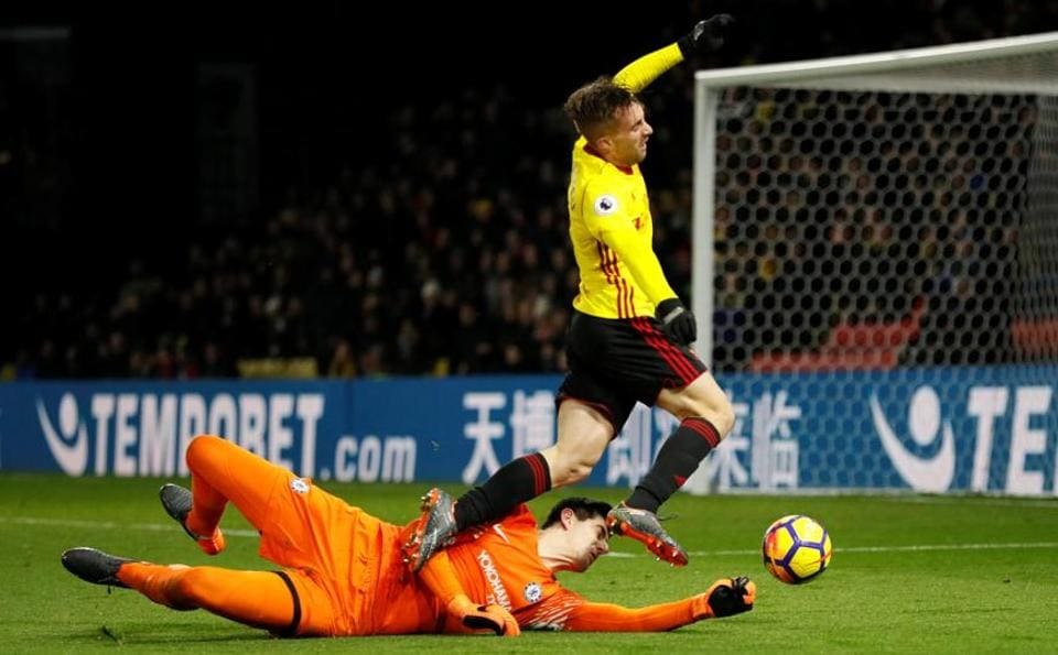 Chelsea's Thibaut Courtois fouls Watford's Gerard Deulofeu for a penalty during their Premier League meeting at Vicarage Road on Monday.