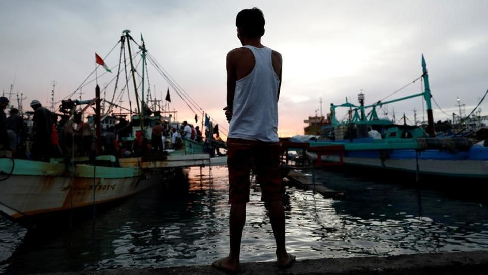 A man, whose wife was arrested in an anti-drug operation and found dead a day later, stands near fishing boats. The 28-year-old man was a shabu user and dealer himself. During one of the deadliest chapters of the drug war in August 2016, he said his partner and mother of his children was murdered, her body found riddled with bullet wounds in the head and chest. (Dondi Tawatao / REUTERS)