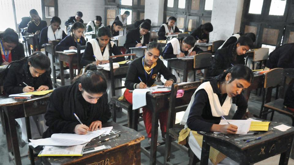 Students appear in the Class 12 examination of Uttar Pradesh Board at an examination centre in Moradabad on Tuesday.