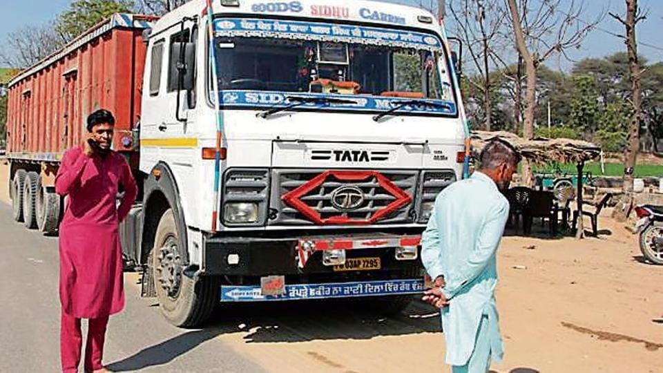 A truck held up at a 'goonda tax' collection point (right) on the outskirts of Bathinda.