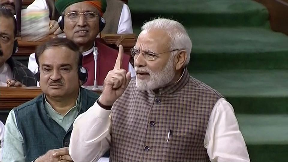"""Prime Minister Narendra Modi replied to the debate on the motion of thanks to the president's address in the Lok Sabha on Wednesday. The Congress party ignored the nation to """"serve one family"""", said Prime Minister Narendra Modi as some Opposition MPs shouted slogans against him. (PTI)"""