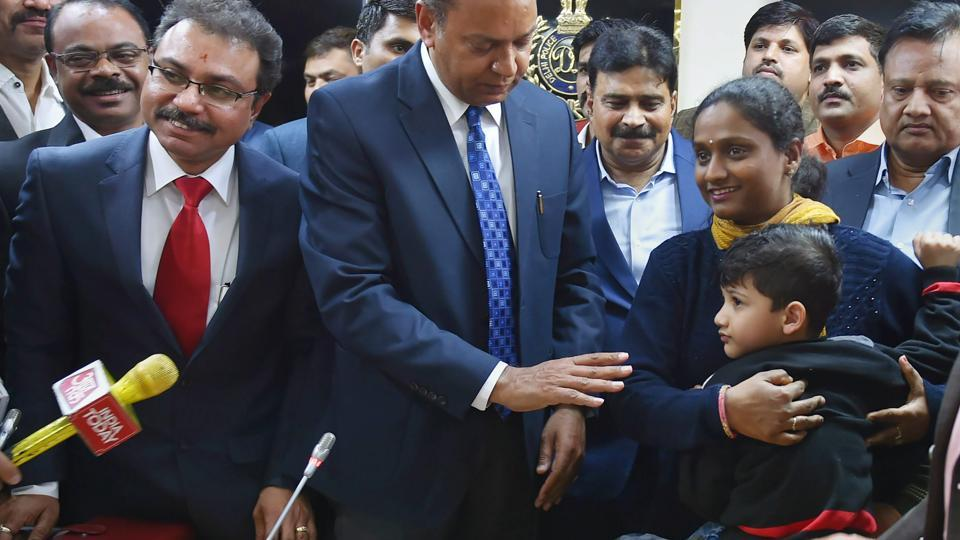 The five-year-old child (extreme right), who was abducted from his school bus a day before Republic Day in Delhi, with his mother after being rescued by Delhi Police, at a press conference in New Delhi on Tuesday.