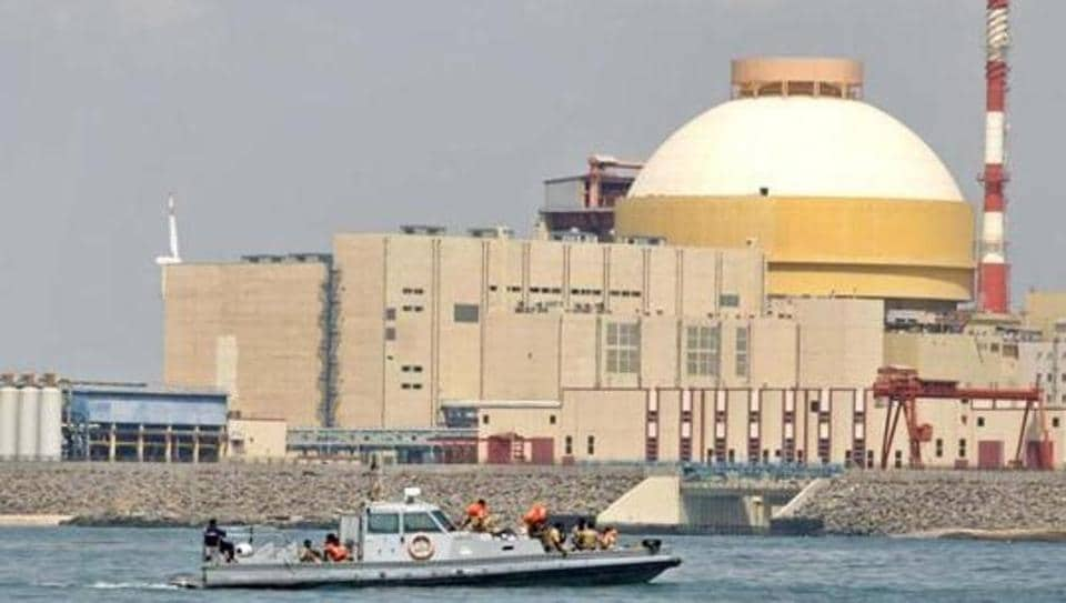 Coast guards ride on a boat near the Kudankulam Atomic Power Project at Kudankulam in Tamil Nadu.