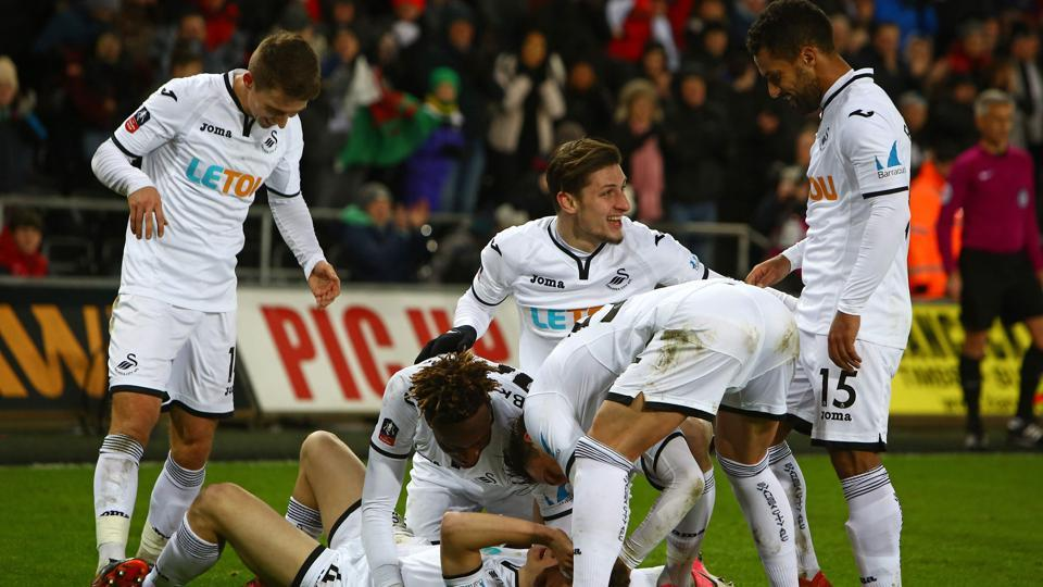 Swansea creates record with 8 goals