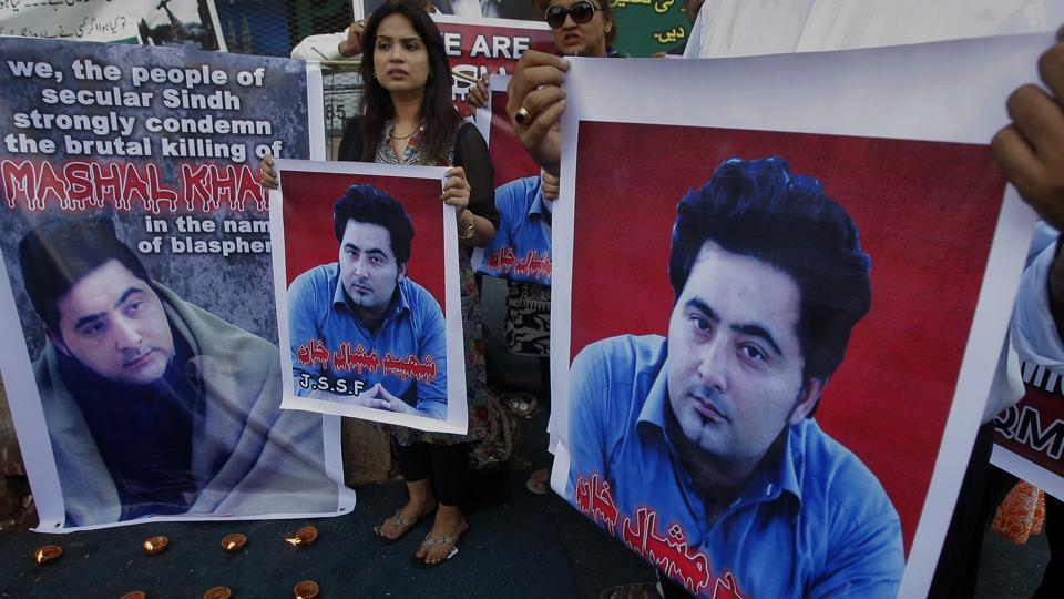 In this April 22, 2017 file photo, members of a Pakistani civil society group demonstrate against the killing of university student Mashal Khan in the northwestern city of Mardan.