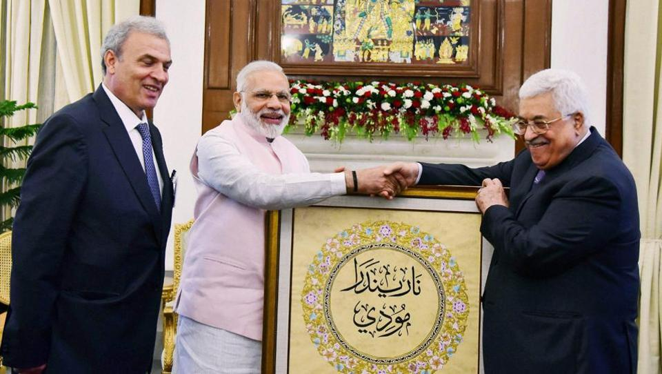 President of Palestine Mahmoud Abbas presents to Prime Minister Narendra Modi a portrait with his name inscribed in Arabic in New Delhi