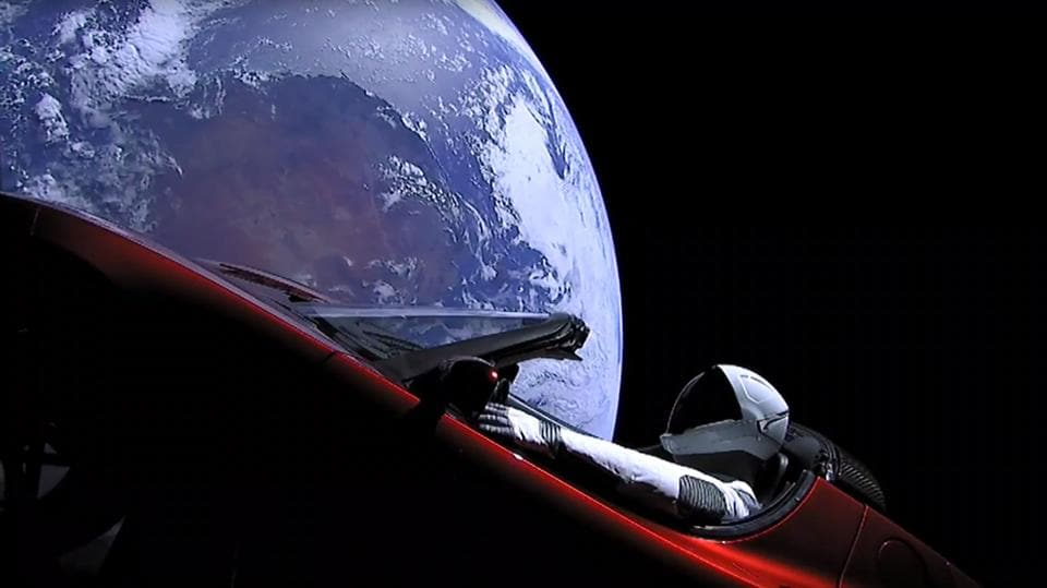 This still image taken from a SpaceX livestream video shows 'Starman' – a mannequin in a spacesuit – sitting in SpaceX CEO Elon Musk's cherry red Tesla roadster after the Falcon Heavy rocket delivered it into orbit around the Earth on February 2, 2018.