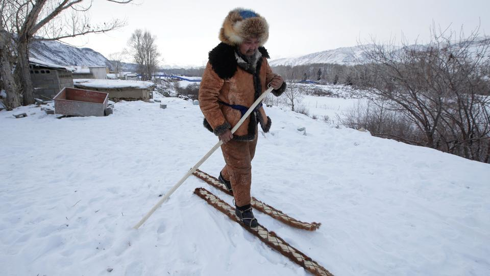 Slanbek, 63, a ski craftsman tests horse-hide skis in the outskirts of Altay, China. For much of the year, skiing is the only way to get around Khom, a village of wooden cabins, five hours' drive from the nearest major town in Xinjiang. Cave paintings here lay a claim to the origin of skiing, much older than Russia's and the government is keen to cash in on it, before the practice dies out. (Jason Lee / REUTERS)