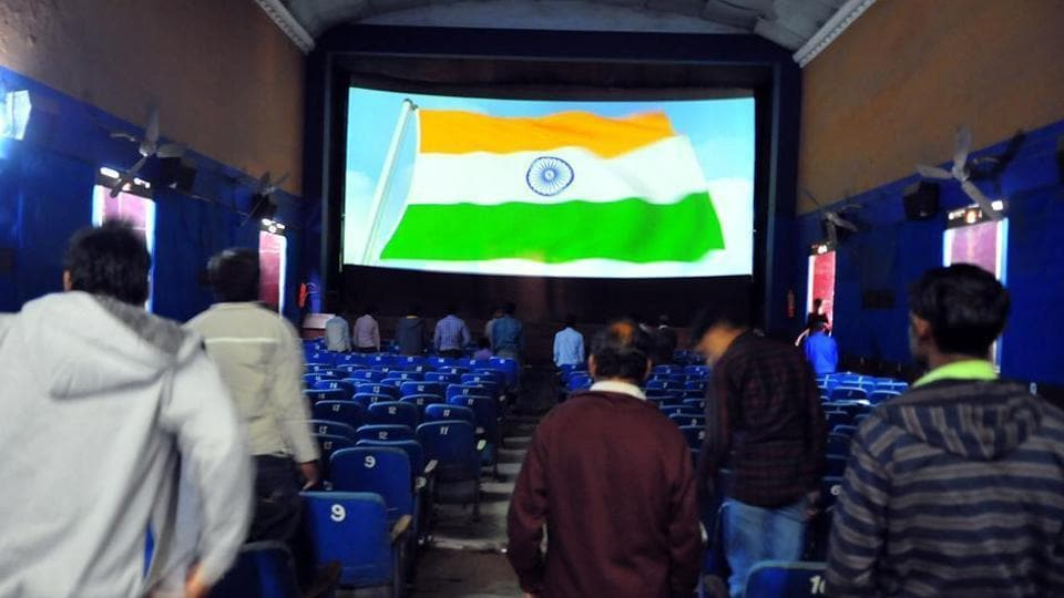 Cinema-goers stand for national anthem before a movie.