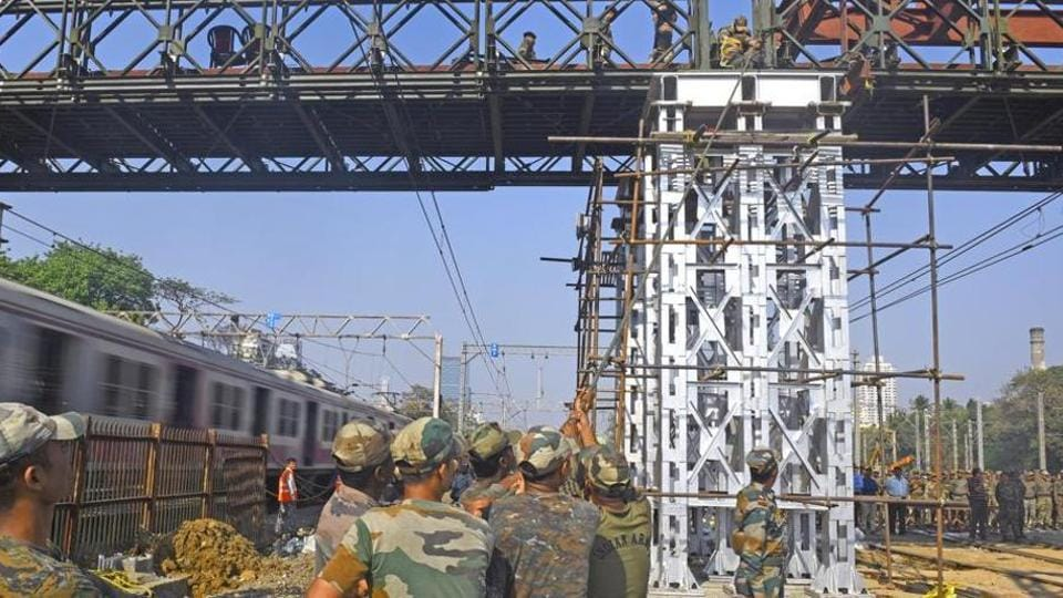 The Indian Army's Bombay Sappers undertaking work on the Elphinstone Road foot over-bridge.