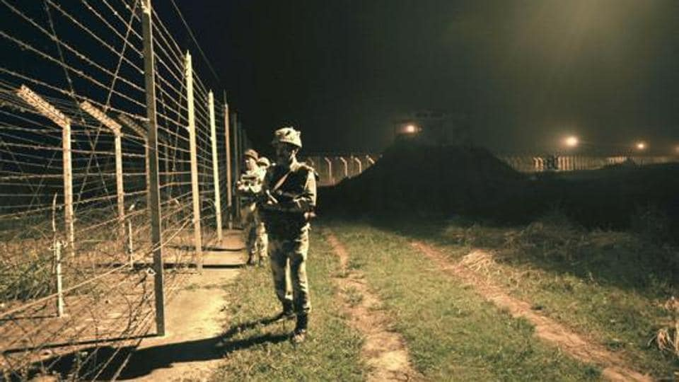 Border Security Force (BSF) soldiers on guard during a night patrol near the fence at the India-Pakistan International Border at the outpost of Akhnoor sector, about 40 km from Jammu.